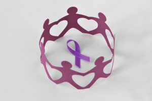Paper People in circle around purple Alzheimer's ribbon