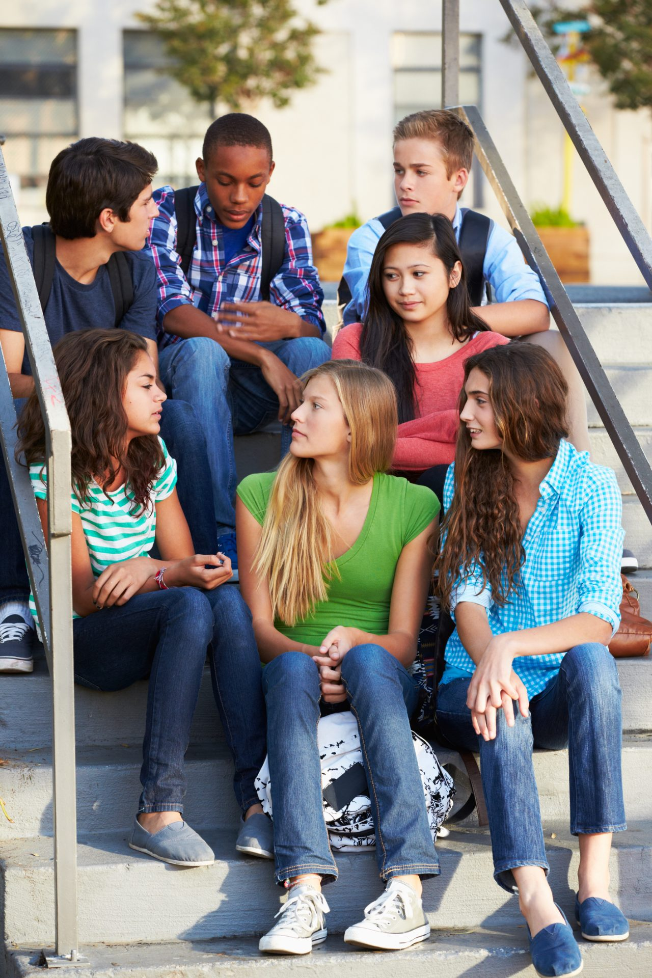 Group of diverse teens on steps