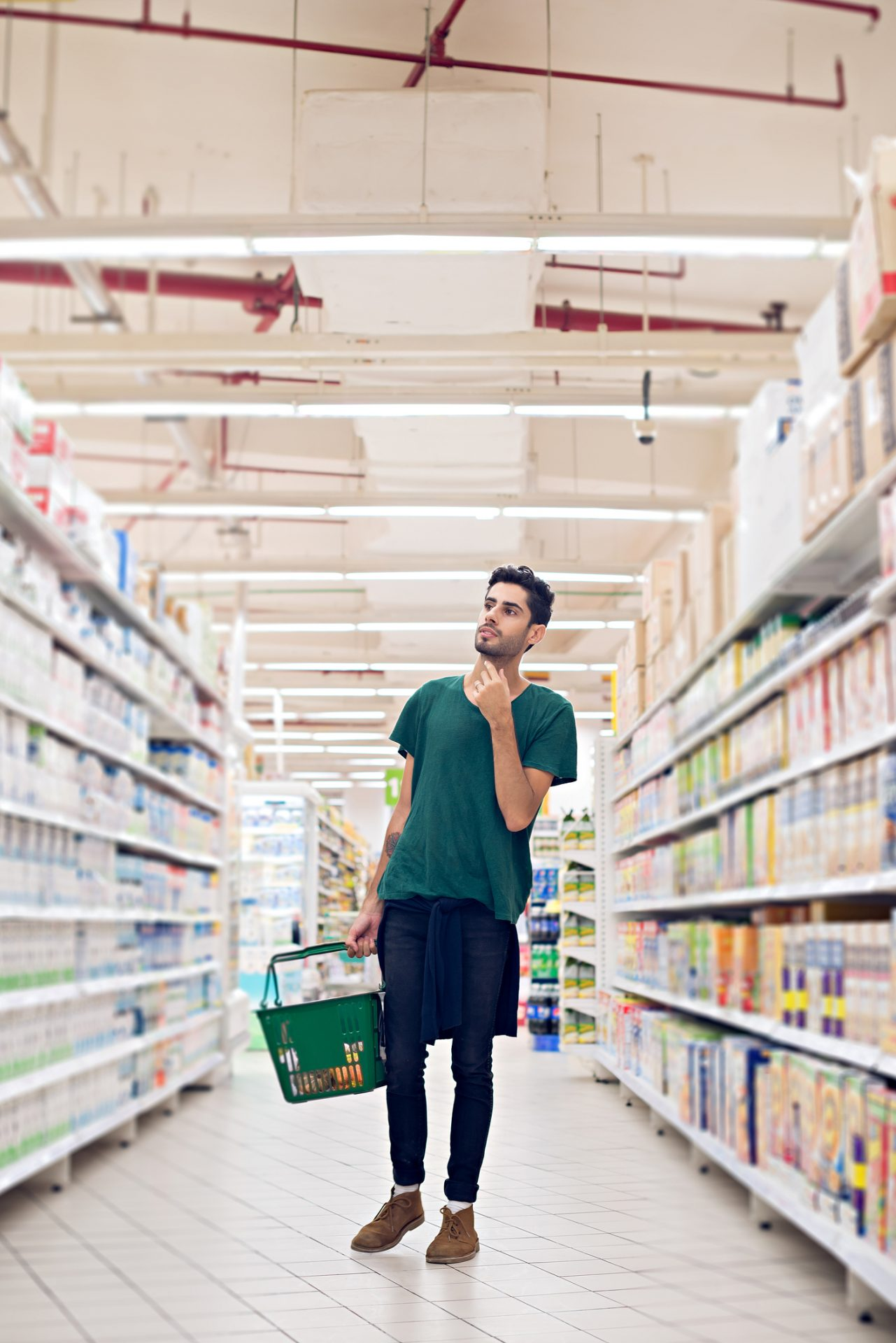 Young man grocery shopping