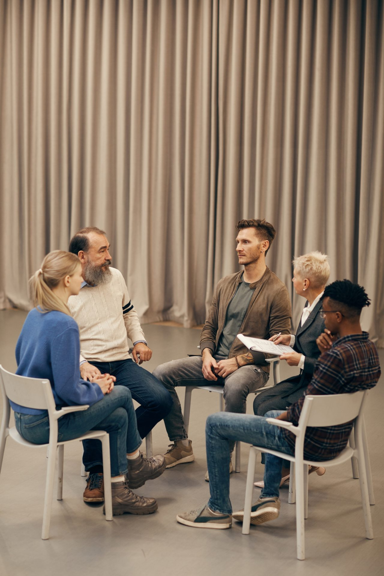 group of people in circle talking
