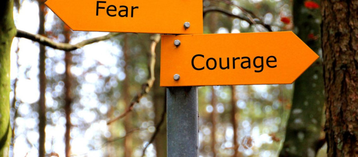 Fear and Courage written on a sign